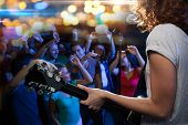 holidays, music, nightlife and people concept - close up of singer playing electric guitar and singi poster
