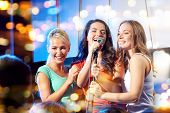 bachelorette party, karaoke, music concert and holidays concept - three happy young women or girls b poster