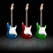 pic of stratocaster  - three electric guitars of different colors with reflections - JPG