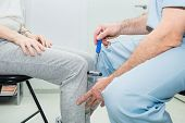 The Neurologist Testing Knee Reflex On A Female Patient Using A Hammer. Neurological Physical Examin poster