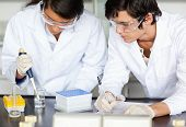 Scientists making an experiment in a laboratory