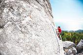 Постер, плакат: A Rock Climber On A Rock
