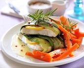 Steamed Fish Fillets Wrapped In Leek With Vegetables. poster