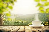 Cup With Tea On Table Over Mountains Landscape With Sunlight. Beauty Nature Background poster