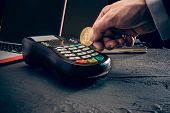 Bitcoin, Credit Card And Pos-terminal. The Golden Bitcoin In Male Hands. Cryptocurrency Bitcoin Coin poster