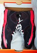 pair of new fun black and pink leather fitness sport shoes in the orange box