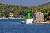 stock photo of safe haven  - Green lighthouse  - JPG