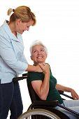 Extended Care Nurse Helping Senior Woman