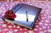 stock photo of tablet pc computer  - Tablet PC computer with pen stylus and red bow - JPG