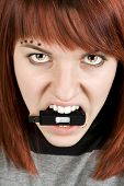 Fire-Eyed Girl Biting Memory Stick poster