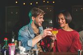 Happy Male Clanging Glasses Of Alcohol Beverage With Cheerful Female. Glad Couple Resting In Bar Con poster