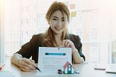 Portrait Of Attractive Asian Real Estate Cheerful To Sign Home Insurance - Business Real Estste Conc poster