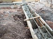 Steel Reinforcement Wooden Framework For Concrete Pouring Build In Construction Site poster