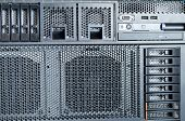 Detail of hard drive cluster in data center poster