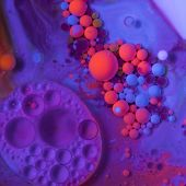 Fluorescent paint. Violet red blue paint bubbles. Liquid paint Oily surface poster