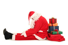 foto of santa claus hat  - Santa Claus sitting on floor with bag of Christmas presents - JPG