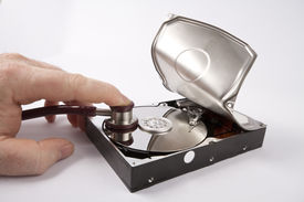 stock photo of wiretap  - listening on open hard disk with a stethoscope - JPG