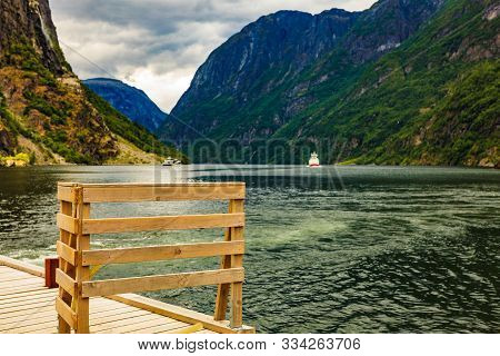poster of Mountains Landscape And Ferry Boat On Fjord Sognefjord In Gudvangen Norway Scandinavia. Tourism Vaca