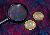 Rare Coins With A Magnifying Glass. Collecting Coins And Banknotes. Coins Of Precious Metals Lie On  poster