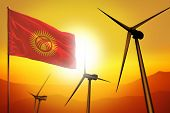Kyrgyzstan Wind Energy, Alternative Energy Environment Concept With Turbines And Flag On Sunset - Al poster