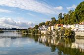 View At A House Front In Passau On The Danube River In Autumn With Multicolored Trees On A Hill And  poster