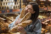 Only The Best And Fresh Bakery. Young Woman In Supermarket With Fresh Bread . Health Food. Healthy F poster