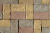 Paving Blocks Of Rectangular Blocks, Color, Yellow, Red, Gray. Road Pavement Made Of Stone. Pedestri poster