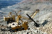 Quarry Truck Carries Coal Mined. Large Quarry Dump Truck. Transport Industry. Mining Truck Is Drivin poster