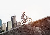 Businessman Riding Uphill By Bike. Nature Landscape With Copy Space. Man In Business Suit Riding Bic poster