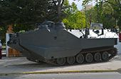 A Military Amphibian Vehicle Of Combat On The Street poster