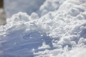 Deep fresh snow closeup glimmering in bright sunlight poster
