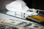 Drug Use, Crime, Addiction And Substance Abuse Concept. Package Of Drugs With Money. Drugs Use And A poster