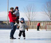 Happy Family At The Skating Rink