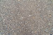 The Texture Of Fine Gravel. Colorful River Pebbles Wet From Rain. Background For Creativity. poster