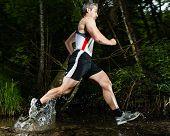 jogger running through water