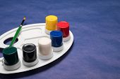 Palette With Paints And Brush. Set Of Paints With A Brush And A Palette. Set Of Tubes Of Paint On A  poster