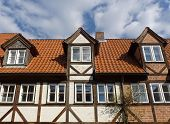 stock photo of gabled dormer window  - three dormers on an old framework house - JPG