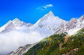 Paraglider Over Mountain Snow Peak, Swiss Alps, Zermatt, Switzerland poster
