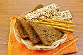 Rye bread and crispbreads in a wicker plate on napkin