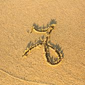 Zodiac sign Capricorn, drawn on the facture beach sand. (zodiac signs series)