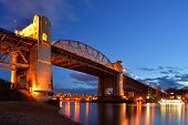 Vancouver's Historic Burrard Bridge At Night