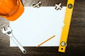 stock photo of reconstruction  - plumbing tools on a white sheet of paper - JPG