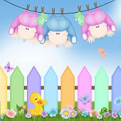 image of triplets  - Baby triplets hanging on clothesline with colorful picket fence - JPG