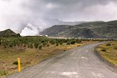 Gravel Road Through Geothermal Area In Iceland