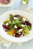 Beetroot and orange salad with goat cheese and pomegranate