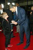 LOS ANGELES - MARCH 18: Rick Yune meets and signs an autograph for an unidentified fans at the premi