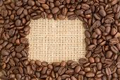 Coffee beans with rectangular indent for copy space on burlap sack