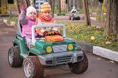 Children In Toy Car