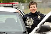 image of lightbar  - a friendly and smiling Hispanic female officer with her patrol car - JPG