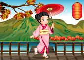Illustration of a lady wearing a pink kimono with an umbrella
